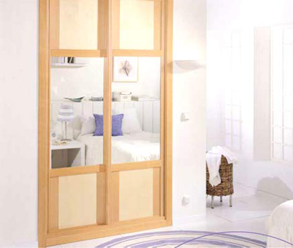 Puertas para armarios empotrados frentes de armario for Revestimiento de armarios empotrados